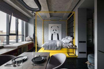 醒目的色彩点缀给这个单色公寓增添了色彩韵味